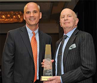 Tim Cawley, Orange & Rockland Utilities, presents the Non-Profit Organization award to Jan Degenshein, Leadership Rockland