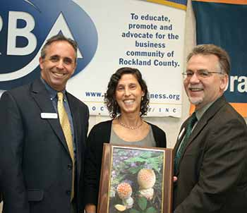 Green Award winner Sonia Caro, Keep Rockland Beautiful (center), receives award from Eric Silber, Green Meadow School and Michael Shilale