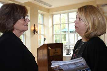 Anne Byne and Amanda Holt compare notes after meeting.