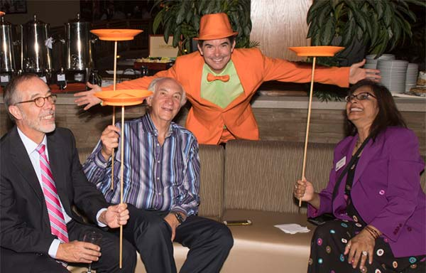 Don Hammond, Meals on Wheels; Howard Dean, Time Hotel and Lena Bodin, People Resource Strategies have fun twirling plates