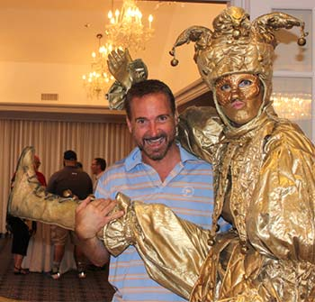 Architect Joseph Minuta posing with the Gold Anniversary Jester