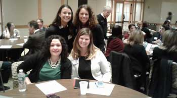 Elaine Winship, St. Thomas Aquinas College Professor sitting with Danielle Kobryn, STAC and Courtney Olsen, student and Jenny Mirmelstein, Rockland BOCES and PMC co-chair.